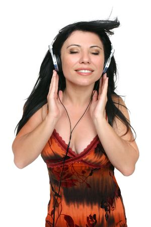aural: Audiophile.  A woman listening to quality high fidelity music.