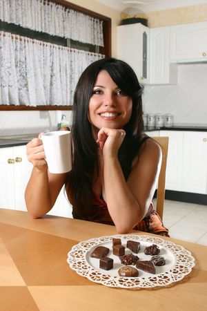 decadent: A woman indulges in coffee and decadent chocolate truffles