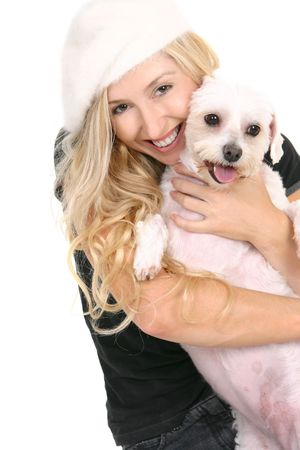 lovable: A smiling woman cuddling a cute lovable white dog Stock Photo