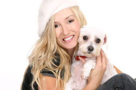 tierschutz: Ein Weibchen sitzt und umarmt ein wundervoller Hund wei�