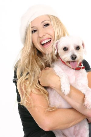 Laughing female holding a cute small white dog photo