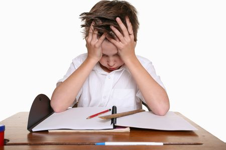 A frustrated, upset child, or child with learning difficulties. Stock Photo