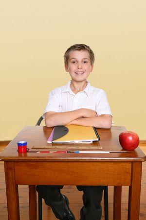 understanding: School boy sitting up straight in class