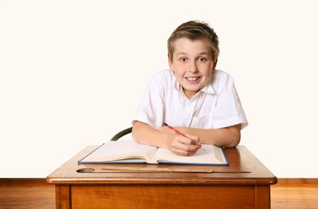 comprehension: Eager happy school student sitting at desk Stock Photo