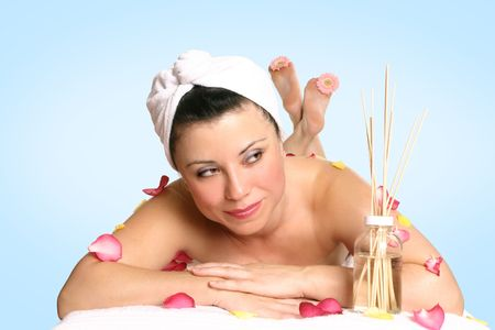 lymphatic drainage therapy: A resting woman ready for beauty therapy, massage or aromatherapy treatment