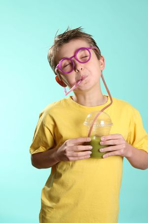sustenance: Enjoying a green health juice containing wheatgrass, barley grass and sprirulina.  A great way to cleanse and detoxify the internal organs. Stock Photo