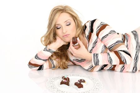 savour: A chocolate addict enjoying a selection of chcolate truffles.