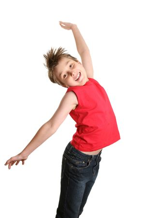 Zest for Life.  Boy full of energy, jumping into the air photo