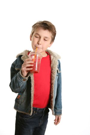 sipping: Child sipping a freshly made fruit juice through a straw.