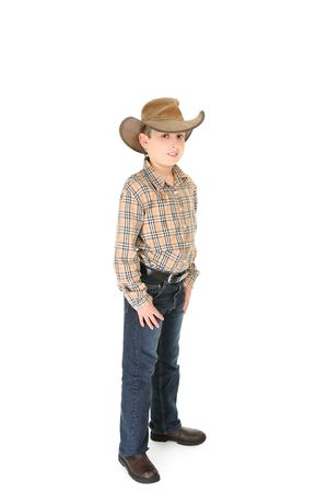 akubra: A country boy wearing a shirt jeans and leather cowboy hat. Stock Photo