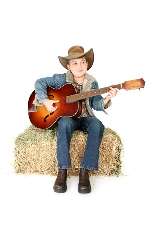 stockman: A child happily playing an acoustic guitar.