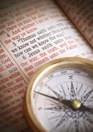 Compass and bible depicting popular bible verse John 14:5-6  How do we know the way.  I am the way the truth and the life....etc.   Focus to bible text Stock Photo