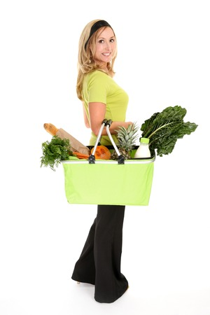 reusable: Woman with a shopping bag filled with nutritious fruit and vegetables,  Stock Photo