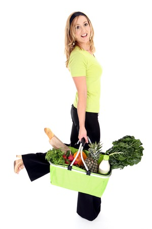 not full: No more plastic bags.  Eco aware shopper using an eco friendly shopping bag full of natural fresh groceries milk and bread. Reusable bag folds flat when not in use. Stock Photo