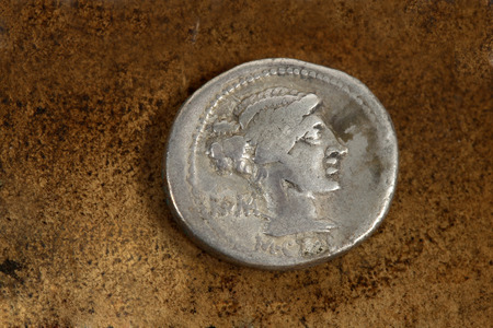 ar: M. Porcius Cato  Rome.   Front side of Roman Republic (200-30bc) silver coin AR denarius (89bc) depicting female draped hair taken in chignon.  Behind the nape of the neck, ROMA, Under the neck, M.Cato.  From the time of Caesar,   Issuance of coinage was