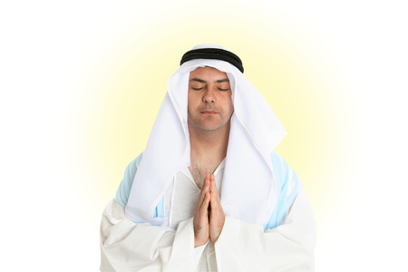 thoub: A goldly man hands together in prayer.