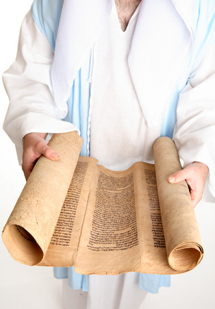 Focus to scroll.The Torah for reading in public must be written on the skin (parchment) of a clean animal, beast or fowl (comp. Lev. xi. 2 et seq.). The parchment must be prepared specially for use as a scroll, with gallnut and lime and other chemicals th photo
