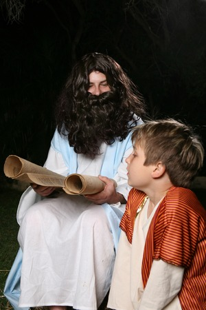 Jesus with a child or other biblical man (eg Elijah the prophet teaching Samuel)  reading and teaching the scriptures to an attentive child.   photo