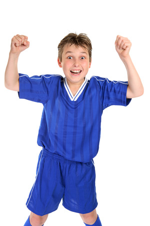 elated: An elated boy celebrates with two fists in the air