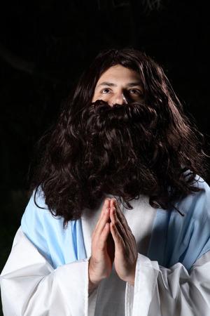 Biblical man or prophet in prayer and looking heavenward. photo