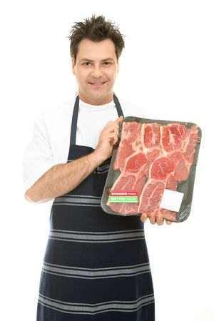 Congenial butcher holding up some fresh tender steak