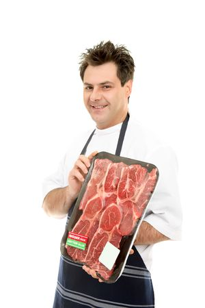 congenial: Smiling butcher holding meat tray Stock Photo