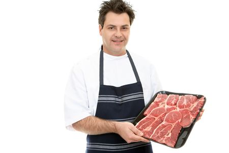 A butcher shows a tray of beef steak. Stock Photo