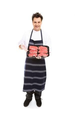 A butcher presents some boneless meat cuts.