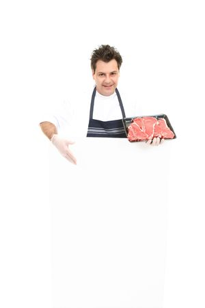 specials: Butcher presenting an advertising sign or specials board.