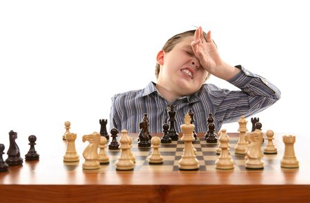 Chess player anguishes over bad move photo