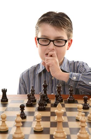 A young chess player contemplates a game plan or strategic move. Stock Photo - 1963991