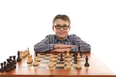strategic advantage: Chess champion poses and  smiles at his winning move