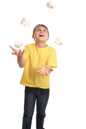 A boy juggling small gift boxes Stock Photo