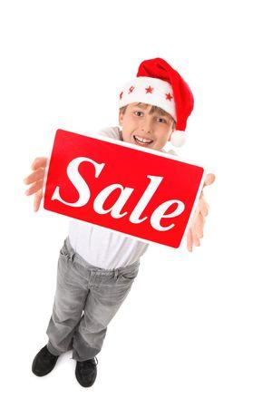 적합: Standing child holding a sale sign up high suitable for pre or post Christmas sales