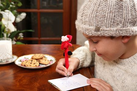wishlist: A child writes out his Christmas wishlist for Santa on Christmas Eve.