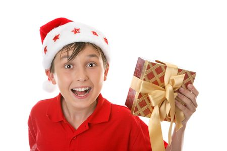 jovial: Excited jovial child holds a Christmas gift. Stock Photo