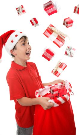 goodies: Lots of presents fall into a young boys Christmas sack to his delight. Some motion visible in presents.