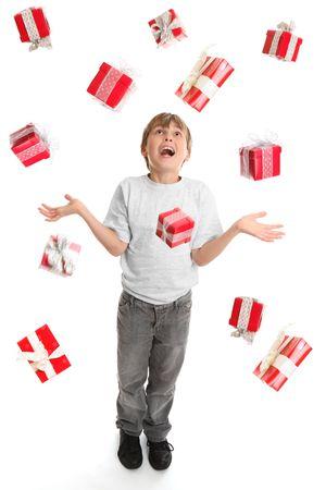 awe: A child in awe at the abundance of gifts fallling around him like rain. Stock Photo