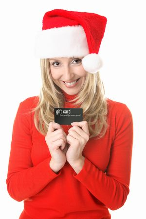 Girl wearing a festive  santa hat ready to spend some money, holding a gift card, store card or credit or debit card or other membership  or business card.  Insert your own card or replace my text with your own message. photo