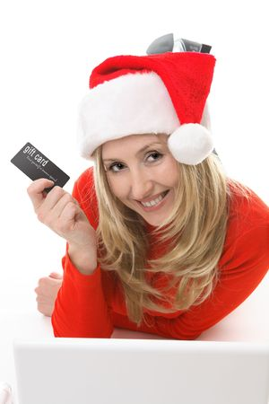 Save your legs.  Blonde santa girl with a gift card or credit card conveniently shopping online.  Add your own card or replace the test with your own design. Stock Photo - 2092934