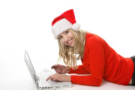 A female using a laptop and shopping online buying  gifts at Christmastime. Stock Photo - 2092933