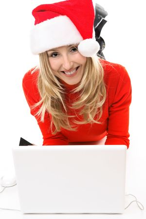 Christmas girl on a laptop computer, shopping for gifts,  banking, etc online. Stock Photo - 2101287