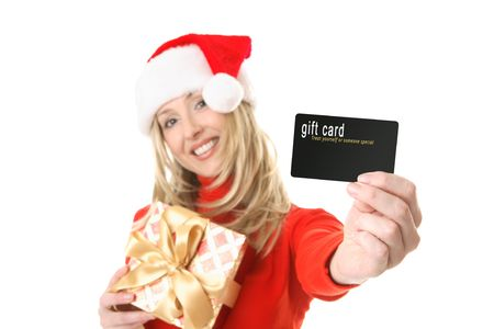 A woman holding a gift and outstretched arm showing a gift card, credit card or other card or object.  Focus is the hand and card.  Change the card or text to suit your needs.