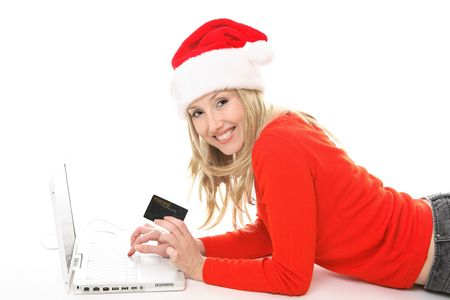 Girl using a card to shop safely  online.  She has a card in one hand and is looking up and smiling.  Change the text or add in your own card or credit card. photo