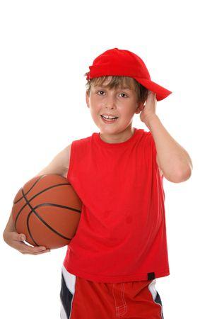 perspiring: Flushed child holding a basketball aftera game.