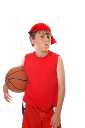 A hot and sweaty young player with attitude takes a break from a game of basketball. photo