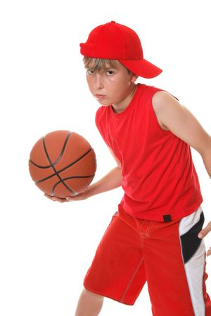 A boy plays a game of basketball photo