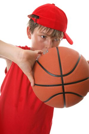 A young active boy playing with a basketball photo