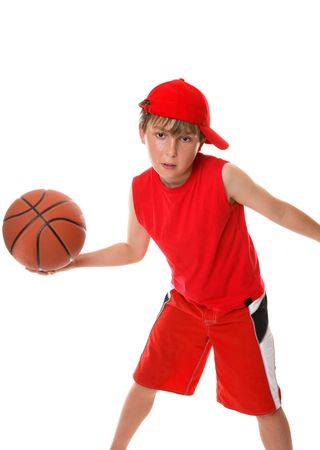 An active boy plays with a basketball photo