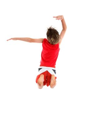 lebensfreude: Ein ekstatische Junge Spr�nge mit den Armen in einer grande Haltung (an zweiter Stelle und dritte Position) Lizenzfreie Bilder